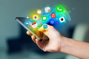 Hand holding smartphone with colorful app icons concept